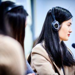 Student listening to audio with headphones
