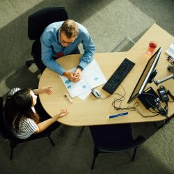 Colleague and student sitting at a desk